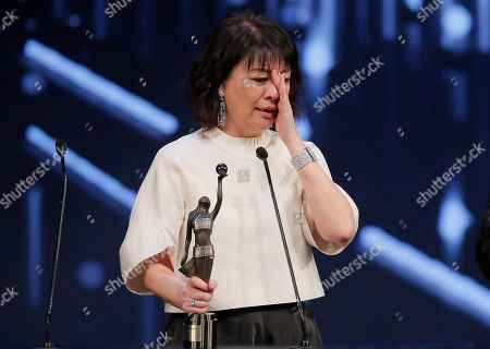 Stock Picture of Elaine Jin Taiwanese actress Elaine Jin reacts after winning the Best Supporting Actress award for her role in the movie ' Port Of Call ' at the 35th Hong Kong Film Awards in Hong Kong