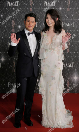 Stock Picture of Aaron Kwok, Jacky Cai Hong Kong actor Aaron Kwok and Chinese actress Jacky Cai pose on the red carpet of the Hong Kong Film Awards in Hong Kong