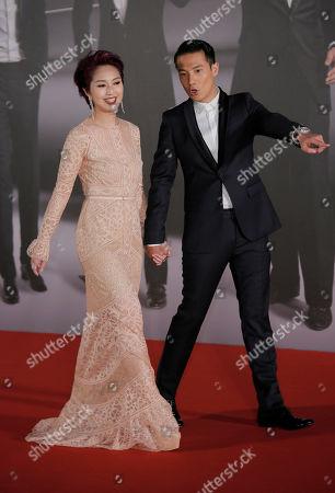 Miriam Yeung, Real Ting Hong Kong actress Miriam Yeung and her husband Real Ting pose on the red carpet of the Hong Kong Film Awards in Hong Kong