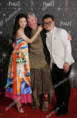 Jessie Li, Michael Ning, Christopher Doyle From left, Chinese actress Jessie Li, Australian-Hong Kong cinematographer Christopher Doyle and Hong Kong actor Michael Ning pose on the red carpet of the Hong Kong Film Awards in Hong Kong