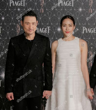 Jacky Cheung, Karena Lam Hong Kong actor Jacky Cheung and actress Karena Lam pose on the red carpet of the Hong Kong Film Awards in Hong Kong