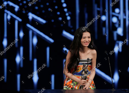 """Jessie Li Chinese actress Jessie Li reacts after winning the Best Actress award for her role in the movie """"Port Of Call"""" at the 35th Hong Kong Film Awards in Hong Kong"""