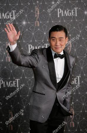 Tony Leung Ka-fai Hong Kong actor Tony Leung Ka-fai poses on the red carpet of the Hong Kong Film Awards in Hong Kong