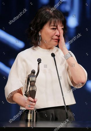 Elaine Jin Taiwanese actress Elaine Jin reacts after winning the Best Supporting Actress award for her role in the movie ' Port Of Call ' at the 35th Hong Kong Film Awards in Hong Kong