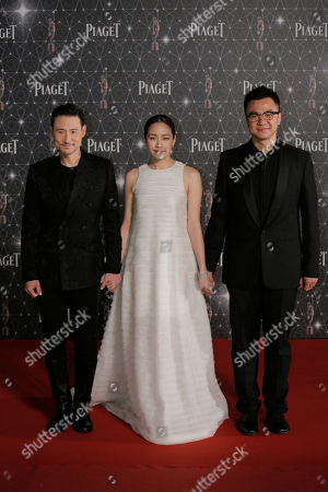 Jacky Cheung, Karena Lam, Steve Yuen From left, Hong Kong actor Jacky Cheung, actress Karena Lam and director Steve Yuen pose on the red carpet of the Hong Kong Film Awards in Hong Kong