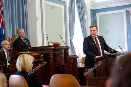 Iceland's Prime Minister Sigmundur David Gunnlaugsson, right, gives a statement at the Parliament regarding the Panama papers released yesterday, in Reykjavik on . Iceland's prime minister insisted Monday he would not resign after documents leaked in a media investigation allegedly link him to an offshore company that could represent a serious conflict of interest, according to information leaked from a Panamanian law firm at the center of an international tax evasion scheme