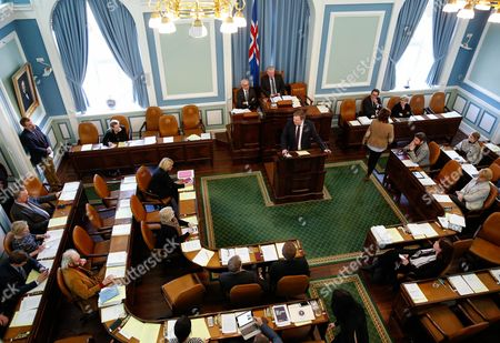 The Iceland's Prime Minister Sigmundur David Gunnlaugsson, centre, stands at the lectern to give a statement at the Parliament regarding the Panama papers released yesterday, in Reykjavik on . Iceland's prime minister insisted Monday he would not resign after documents leaked in a media investigation allegedly link him to an offshore company that could represent a serious conflict of interest, according to information leaked from a Panamanian law firm at the center of an international tax evasion scheme