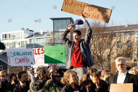 People gather to demonstrate against Iceland's prime minister Sigmundur David Gunnlaugsson, in Reykjavik on . Iceland's prime minister insisted Monday he would not resign after documents leaked in a media investigation allegedly link him to an offshore company that could represent a serious conflict of interest, according to information leaked from a Panamanian law firm at the center of an international tax evasion scheme
