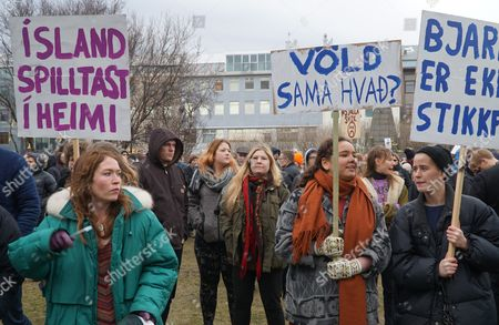 People hold banners and protest in front of Parliament building in Reykjavik, Iceland, . The leak of millions of records on offshore accounts claims its first high-profile victim as Iceland's prime minister Sigmundur David Gunnlaugsson resigns amid outrage over revelations he used such a shell company to conceal a conflict of interest