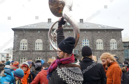 Stock Image of People protest in front of Parliament building in Reykjavik, Iceland, . The leak of millions of records on offshore accounts claims its first high-profile victim as Iceland's prime minister Sigmundur David Gunnlaugsson resigns amid outrage over revelations he used such a shell company to conceal a conflict of interest