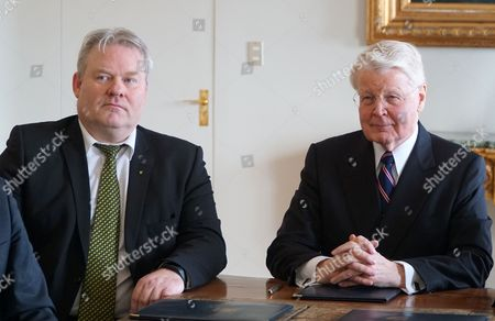 Iceland's President Olafur Ragnar Grimsson, right, is photographed by the media with Iceland's new Prime Minister Sigurdur Ingi Johannsson, at the president's residence Bessastadir, Reykjavik, Iceland, . Iceland's fisheries minister said Thursday the island nation's president has approved a proposal that makes him Iceland's new prime minister, a development that comes several days after his predecessor resigned after being linked to an offshore account