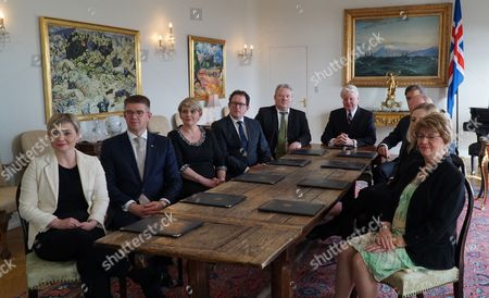 Iceland's President Olafur Ragnar Grimsson sits at the head of the table with Iceland's new Prime Minister Sigurdur Ingi Johannsson, fifth left, and the newly formed cabinet at the president's residence Bessastadir, Reykjavik, Iceland, . Iceland's fisheries minister said Thursday the island nation's president has approved a proposal that makes him Iceland's new prime minister, a development that comes several days after his predecessor resigned after being linked to an offshore account