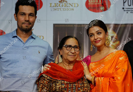 """Aishwarya Rai Bachchan, Randeep Hooda Bollywood actors Aishwarya Rai Bachchan, right and Randeep Hooda, left pose with Dalbir Kaur, sister of Sarbjit Singh during a press conference to promote their upcoming film """"Sarbjit"""" in Ahmadabad, India, . The film is scheduled to be released on May 20"""