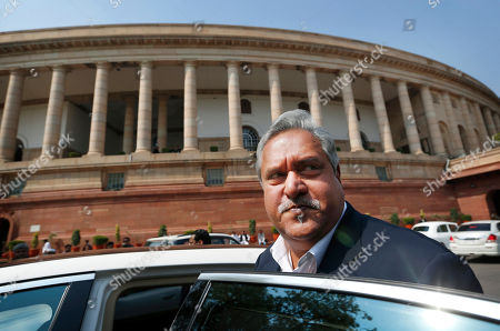 Vijay Mallya Indian business tycoon and owner of Kingfisher Airlines Vijay Mallya gets into his car outside the Parliament in New Delhi, India. India has revoked the passport of the flamboyant Indian businessman Mallya accused of fleeing to London in March while owing more than a billion dollars to Indian banks. External Affairs Ministry spokesman Vikas Swarup said that the decision to revoke Mallya's passport was taken considering the evidence gathered by India's Enforcement Directorate, which has been investigating the tycoon's massive debts
