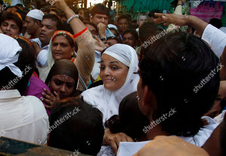 People from the Muslim community shout slogans to oppose a protest demonstration by women's rights activist, Trupti Desai and her followers who oppose a ban on women entering the Muslim Shrine of Haji Ali Dargah, in Mumbai, India, . Desai, who asserts that women have an equal right to pray, has earlier campaigned successfully to ensure Hindu women get entry into temples that had traditionally never allowed women inside