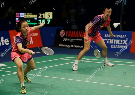 Ma Jin, Xu Chen China's Ma Jin, left, and her teammate Xu Chen compete against China's Huang Yaqiong and Lu Kai during the mixed doubles semifinal match at the Indonesia Open badminton tournament at Istora Stadium in Jakarta, Indonesia