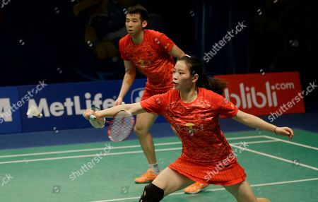 Huang Yaqiong, Lu Kai China's Huang Yaqiong, right, and her teammate Lu Kai compete against China's Xu Chen and Ma Jin during the mixed doubles semifinal match at the Indonesia Open badminton tournament at Istora Stadium in Jakarta, Indonesia