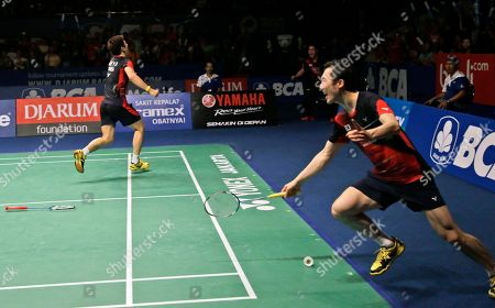 South Korea's Yoo Yeong-seong, right, and Lee Yong-dae celebrate after defeating China's Chai Biao and Hong Wei during their men's doubles final match at the Indonesia Open badminton tournament at Istora Stadium in Jakarta, Indonesia