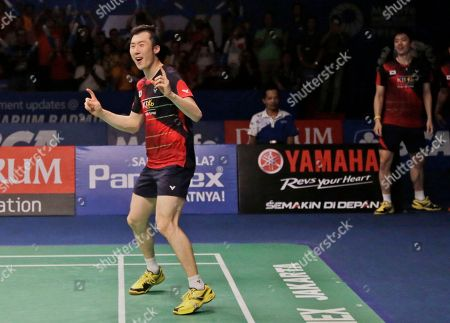South Korea's Yoo Yeong-seong, left, and Lee Yong-dae, right, celebrate after defeating China's Chai Biao and Hong Wei during their men's doubles final match at the Indonesia Open badminton tournament at Istora Stadium in Jakarta, Indonesia