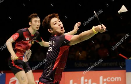 South Korea's Lee Yong-dae, right, and Yoo Yeong-seong compete against China's Chai Biao and Hong Wei in their men's doubles final match at the Indonesia Open badminton tournament at Istora Stadium in Jakarta, Indonesia
