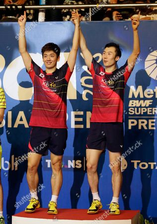 South Korea's Lee Yong-dae, left, and Yoo Yeong-seong celebrate on the podium after defeating China's Chai Biao and Hong Wei in their men's doubles final match at the Indonesia Open badminton tournament at Istora Stadium in Jakarta, Indonesia