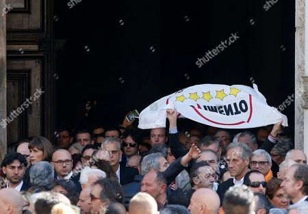 People attend the funeral of the co-founder of Italy's 5-star Movement Gianroberto Casaleggio outside Santa Maria delle Grazie Basilica, in Milan, Italy