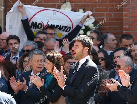 Alessandro Di Battista, right, with Carla Ruocco applaude during the funeral of the co-founder of Italy's 5-star Movement Gianroberto Casaleggio outside Santa Maria delle Grazie Basilica, in Milan, Italy