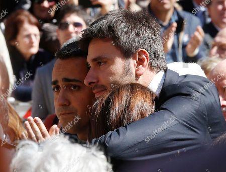 Alessandro Di Battista, right, with Carla Ruocco and Luigi Di Maio, embrace during the funeral of the co-founder of Italy's 5-star Movement Gianroberto Casaleggio outside Santa Maria delle Grazie Basilica, in Milan, Italy