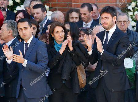 Alessandro Di Battista, right, with Carla Ruocco and Luigi Di Maio, left, applaude during the funeral of the co-founder of Italy's 5-star Movement Gianroberto Casaleggio outside Santa Maria delle Grazie Basilica, in Milan, Italy