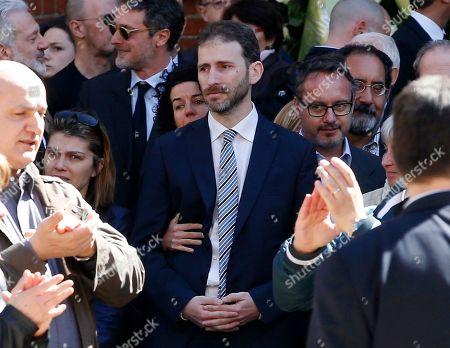 Davide Casaleggio, son of co-founder of Italy's 5-star Movement Gianroberto Casaleggio, stands outside Milan's Santa Maria delle Grazie Basilica, during the funeral of his father, Italy