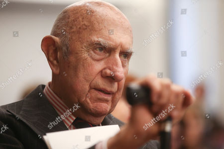 Honorary president of the Italian Fashion chamber, attends a news conference in Milan, Italy, . (AP Photo/Luca Bruno