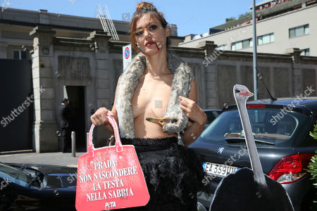 Stock Photo of PETA (People for the Ethical Treatment of Animals) activist DJ and blogger Daniela Martani wears a dress shaped as a dead ostrich, during a demonstration against the use of exotic animals to produce leather accessories, outside the Prada fashion group headquarter, in Milan, Italy