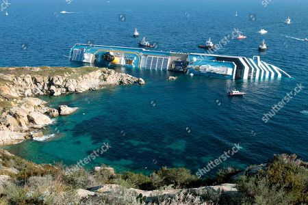 The luxury cruise ship Costa Concordia leans on its side after running aground in the tiny Tuscan island of Giglio, Italy. The captain of the shipwrecked Costa Concordia cruise ship Francesco Schettino was convicted, of multiple charges of manslaughter and sentenced to 16 years in jail, Italian court officials said