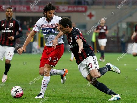 AC Milan's Giacomo Bonaventura, right, challenges for the ball with Carpi's Cristian Zaccardo during the Serie A soccer match between AC Milan and Carpi at the San Siro stadium in Milan, Italy