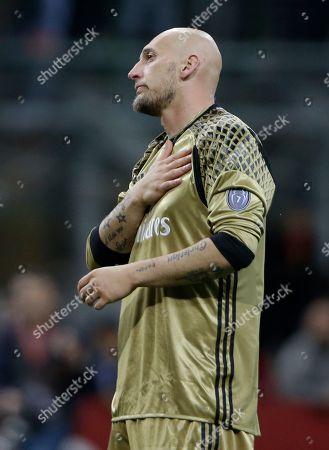 AC Milan goalkeeper Christian Abbiati gestures as he cheers supporters at the end of a Serie A soccer match between AC Milan and Roma, at the San Siro stadium in Milan, Italy