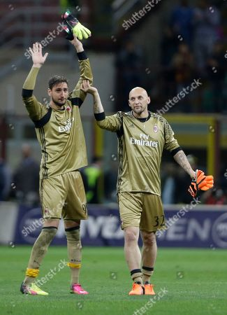 Stock Image of AC Milan goalkeeper Christian Abbiati, right, flanked by AC Milan goalkeeper Gianluigi Donnarumma salutes fans at the end of a Serie A soccer match between AC Milan and Roma, at the San Siro stadium in Milan, Italy