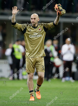 Stock Photo of AC Milan goalkeeper Christian Abbiati waves to supporters at the end of a Serie A soccer match between AC Milan and Roma, at the San Siro stadium in Milan, Italy