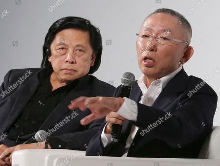 Tadashi Yanai, John Jay Fast Retailing chief executive Tadashi Yanai speaks as Fast Retailing president of Global Creative John Jay, left, listens in Tokyo