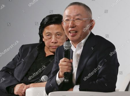 """Tadashi Yanai, John Jay Fast Retailing chief executive Tadashi Yanai speaks to the media next to John Jay, left, president of Global Creative at Fast Retailing, in Tokyo. """"Our challenge is to have people understand our idea of 'lifewear,' transcending national boundaries,"""" said Yanai, who founded Uniqlo's 100,000-employee parent company Fast Retailing in southwestern Japan's Yamaguchi prefecture as a maker of affordable, functional and still popular products like its HeatTech and AIRism underwear"""