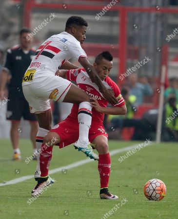 Christian Cuevas, Michel Fernandes Christian Cuevas of Mexico's Toluca, fights for the ball with Michel Fernandes of Brazil's Sao Paulo, left, during a Copa Libertadores soccer match in Toluca