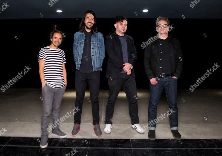 """Ruben Albarran, Emmanuel del Real, Enrique Rangel, and Jose Alfredo Rangel Members of Mexican rock band Cafe Tacuba pose for a picture before an interview in Mexico City, . From left are Ruben Albarran, Emmanuel """"Meme"""" del Real, Enrique """"Quique"""" Rangel and Jose Alfredo """"Joselo"""" Rangel. Cafe Tacuba will be the Latin headliner in this year's massive Vive Latino festival and plan to mark the 20th anniversary of their album """"Avalancha de exitos"""" by performing it from beginning to end"""