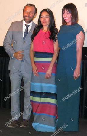 Stock Image of Actress Dolores Heredia, president of the Mexican Film Academy, center, Juan Manuel Bernal, winner of the 2015 Ariel for best actor, left, and Adriana Paz winner of the 2015 Ariel for best actress pose for a portrait after the announcement of the nominees to the 58th Ariel Awards in Mexico City on