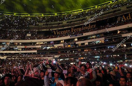 Vicente Fernandez Spectators take pictures as Mexican singer Vicente Fernandez performs at a free concert at Azteca Stadium in Mexico City, . Vicente Fernandez dazzled in his farewell concert in the Azteca Stadium. The star of Mexican regional music toured more than 50 years of experience across the wide repertoire of his farewell concert