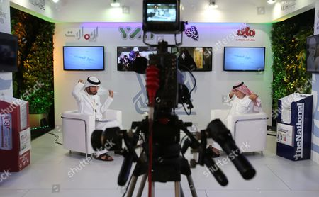An Emirati television anchor and his guest prepare for a program at the Arab Media Forum in Dubai, United Arab Emirates, . Jordan's foreign minister is saying that Palestinian statehood is the most important issue now facing the world and fuels the extremism gripping the Mideast. Nasser Judeh made the comment Tuesday at the Arab Media Forum, an event taking place in Dubai, the commercial hub of the United Arab Emirates