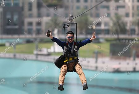 Man enjoys an urban zip line attraction in Dubai, United Arab Emirates, . In the air travel hub of Dubai, there's a new way to fly: A zip line run by extreme sports company XDubai. XDubai, which began its operations in 2015, is associated with Sheikh Hamdan bin Mohammed bin Rashid Al Maktoum, the crown prince of Dubai known by millions for his Instagram exploits