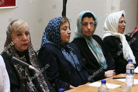 Narges Mohammadi, Shirin Ebadi, Simin Behbahani In this Aug. 27, 2007 photo, prominent Iranian human rights activist Narges Mohammadi, second right, sits next to Iranian Nobel Peace Prize laureate Shirin Ebadi, second left, and the now deceased poet Simin Behbahani, left, while attending a meeting on women's rights in Tehran, Iran. Mohammadi, who is already imprisoned in Iran has been sentenced to 10 years in prison in a new trial, a ruling denounced by the United Nations, as it called for her immediate release. Mohammadi is close to Iranian Nobel Peace Prize laureate Shirin Ebadi, who founded the Defenders of Human Rights Center