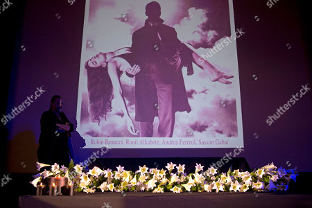 Ronit Elkabetz A man stands next to the coffin of Israeli actress Ronit Elkabetz as her photo is projected in the background, before her funeral, at a cinema in Tel Aviv, Israel, . Elkabetz, a prolific Israeli actress and filmmaker whose work earned her stardom in France as well as at home, died on Tuesday, April 19, 2016. She was 51