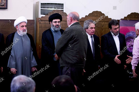 The deputy chief of Hezbollah, Sheik Naim Kassem, left, Sayyed Hashem Safieddine, head of Hezbollah's executive council, second left, Adnan Badreddine, second right, and Hassan Badreddine, right, brothers of top Hezbollah commander Mustafa Badreddine, receive condolences in a southern suburb of Beirut, Lebanon, . Lebanon's militant Hezbollah group said Friday that its top military commander who was supervising its military operations in Syria, Mustafa Badreddine, was killed in an explosion in Damascus, a major blow to the Shiite group which has played a significant role in the conflict next door
