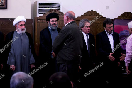 The deputy chief of Hezbollah, Sheik Naim Kassem, left, Sayyed Hashem Safieddine, head of Hezbollah's executive council, second left, Adnan, second right, and Hassan, right, brothers of top Hezbollah commander Mustafa Badreddine, receive condolences in a southern suburb of Beirut, Lebanon, . Lebanon's militant Hezbollah group said Friday that its top military commander who was supervising its military operations in Syria, Mustafa Badreddine, was killed in an explosion in Damascus, a major blow to the Shiite group which has played a significant role in the conflict next door