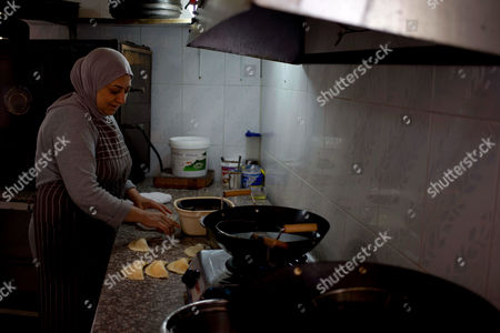 Yazdeh Hindi Yazdeh Hindi a Brazilian-Lebanese cook prepares pastel, a typical Brazilian fast-food dish, at her sister's Pastelaria de Tina Restaurant in the village of Sultan Yaacoub, 9 kilometers (5 miles) from the Syrian border with Lebanon. At the eastern edge of the rural Bekaa Valley, where the rocky hillsides are stippled with cherry trees, a generations-old kinship with Brazil has imbued two Lebanese villages with a Latino spirit. Lusi and Sultan Yaacoub are home to more than one thousand Brazilian nationals, many of whom speak Portuguese as fluently as they do Arabic